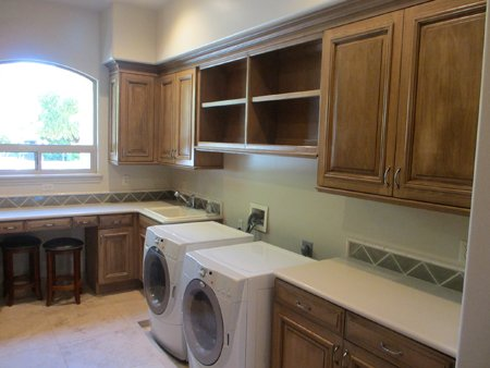 wood kitchen with washer and dryer