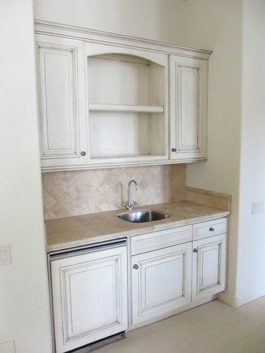 kitchen sink with elegant white cabinets