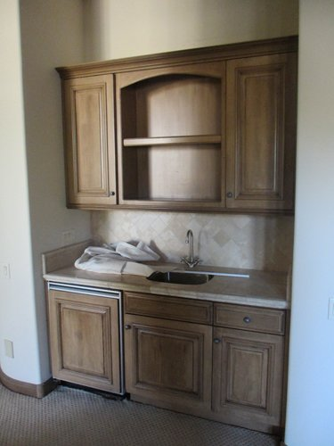 kitchen sink with wood storage
