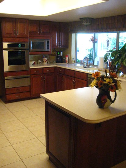 reddish brown kitchen after cabinet refacing