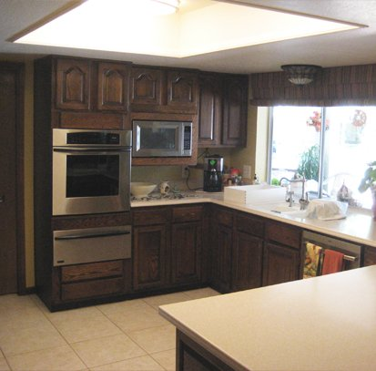 brown kitchen before cabinet refacing