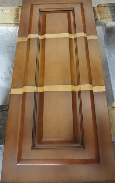 Sample door with three different refinish options for color. The two stripes in the center are the original door color.